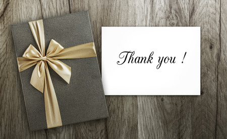 gratefulness: Present with Thank you card on wood, top view