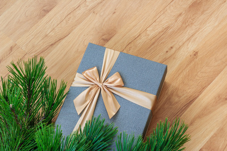 Present under christmas tree closeup view from above, wooden background Stock fotó