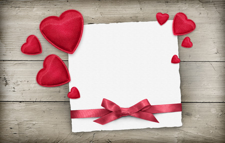 Valentines day empty greeting card with red hearts, ribbon over wood Stock fotó