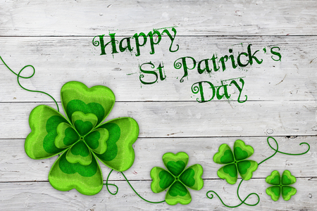 Saint Patricks Day background with green clovers and message