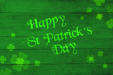 Saint Patricks Day green background with clovers greeting
