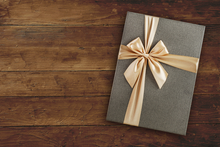 Gift box with over wooden background with copy space