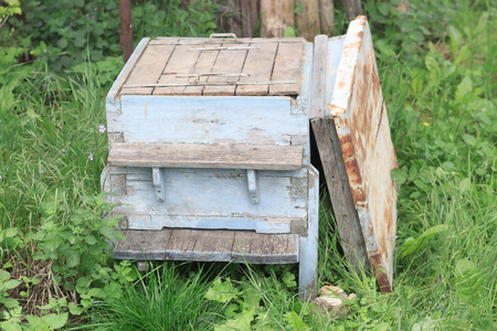 Old empty beehive in the garden with open lid, no bees inside, close view