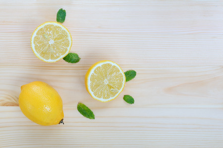 Fresh lemons and mint leaves on the table, top view wooden background with copy space Stock fotó