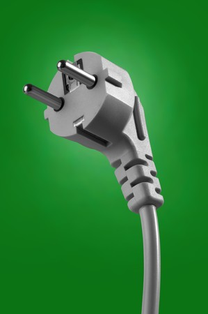 electrical cable with plug on green background Stock Photo - 6933860