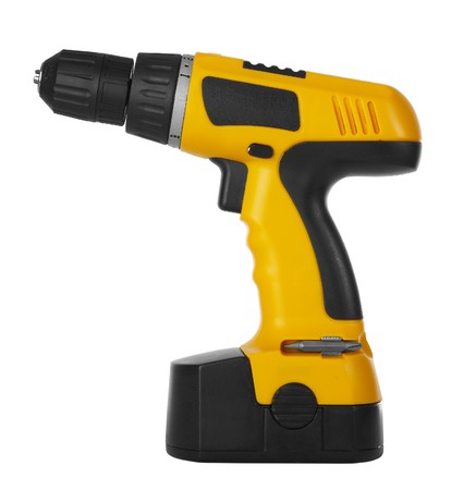 refit: Battery drill on a white background