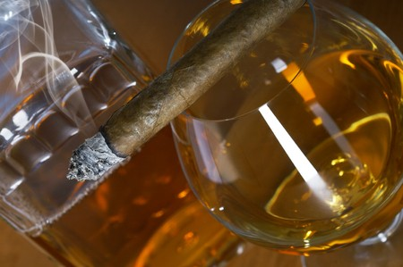 Glass and decanter of whisky with a cigar on a table Stock Photo - 6933932
