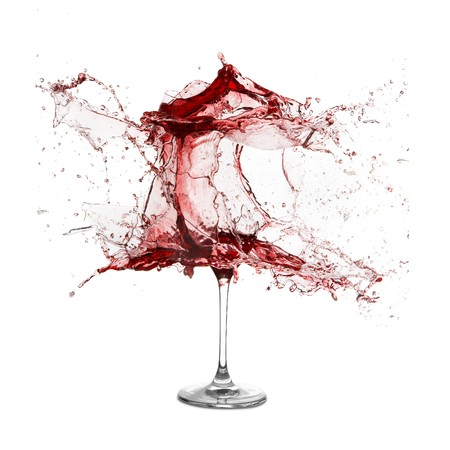 glass break: Explosion of a glass with red wine on a white background