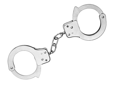Pair of handcuffs isolated on a white background Stock Photo - 7093570