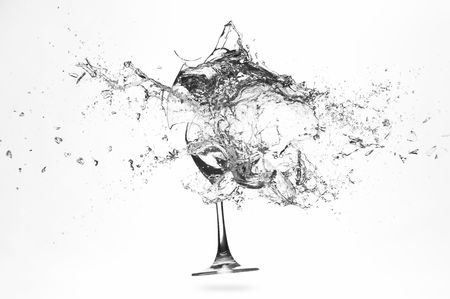 splinters: Explosion of a glass with water on a white background Stock Photo