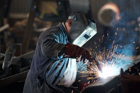 welding worker: Welder man in work Stock Photo