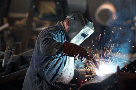 Welder man in work