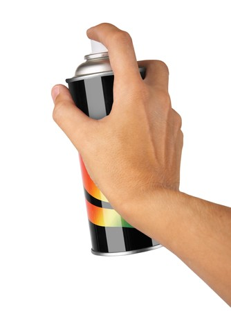 spray paint: graffiti spray can in hand isolated on white background Stock Photo