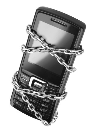 black and white lock: Mobile phone with chain isolated on white background Stock Photo