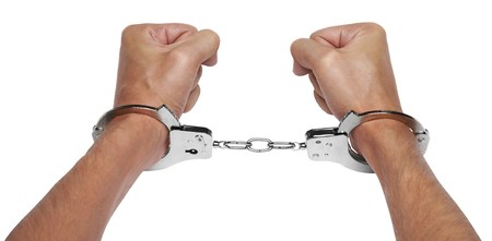 Hands in handcuffs isolated on white background Stock Photo