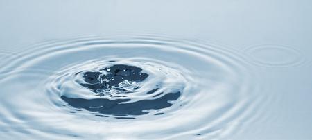 Falling of a drop of water. Water splashing Stock Photo - 8335723