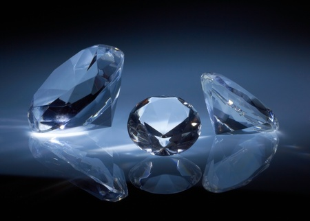 topaz: Shiny diamonds jewel on dark blue background