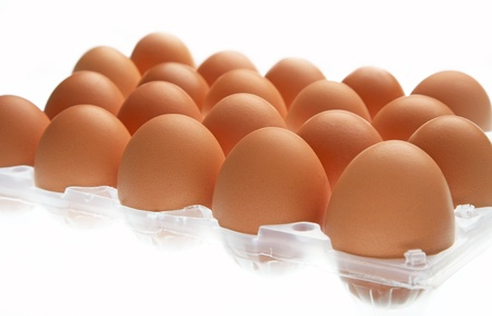 eggs in the package on white background photo
