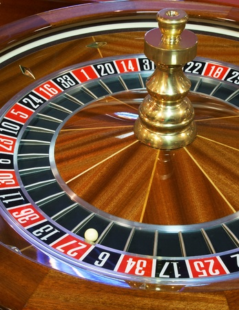 Close up of roulette wheel with ball on 27 Stock Photo - 9991505