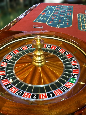 Close up of roulette wheel with ball on 27 Stock Photo