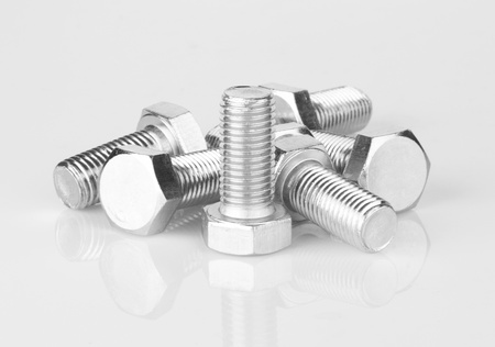Screws with reflection isolated on white background photo