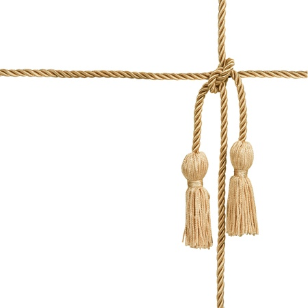 Gold rope with tassel isolated on white Stock Photo