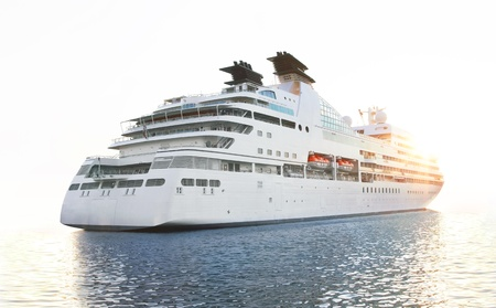 Luxury white cruise ship on a clear day with calm seas Standard-Bild