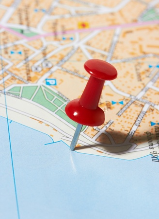 Red pushpin on a city map Stock Photo - 10788104