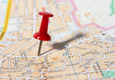 Red pushpin on a city map photo