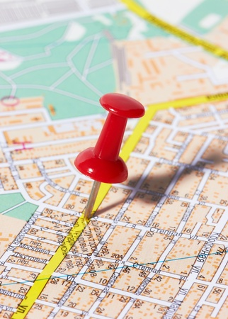 red pushpin: Red pushpin on a city map
