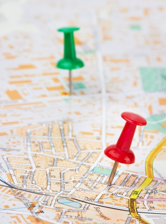 Red and green pushpin on a city map photo