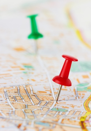 Red and green pushpin on a city map
