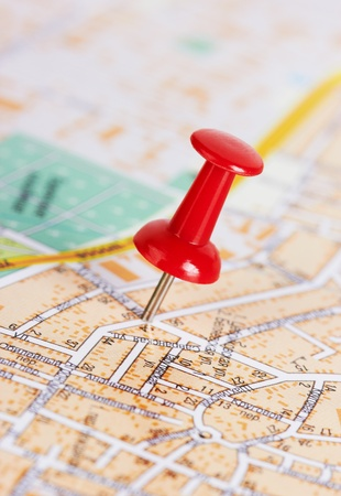 Red pushpin on a city map Stock Photo - 10788885