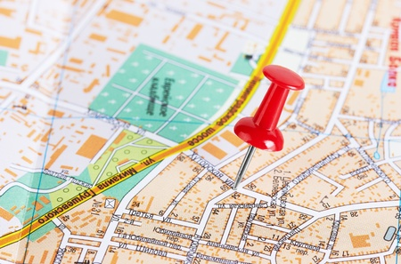 Red pushpin on a city map Stock Photo - 10788891