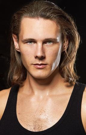 gigolo: Young man portrait on black background Stock Photo