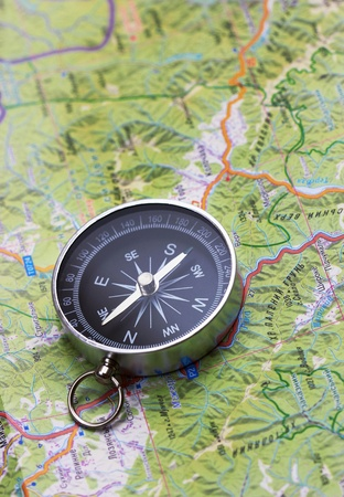 Compass on map, close up photo