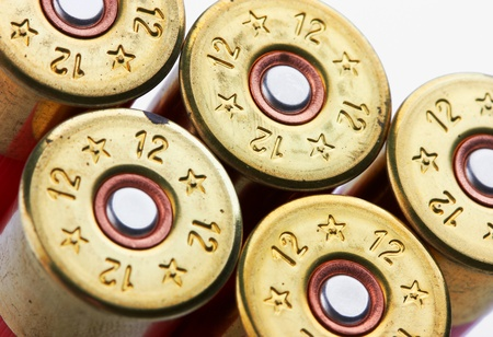 shotgun shells on white background photo