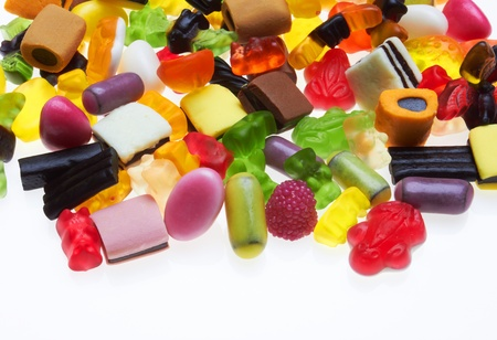 assortment of colorful candy on white background