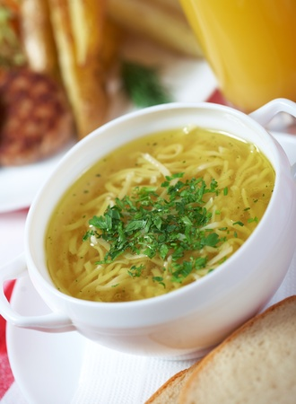 broth: Chicken soup with noodles Stock Photo