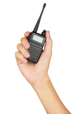 Portable walkie-talkie radio in hand, isolated on white background photo