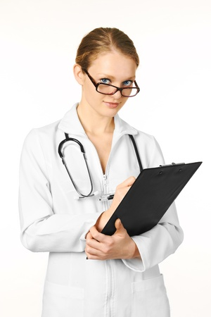 Beautiful young female doctor with stethoscope photo