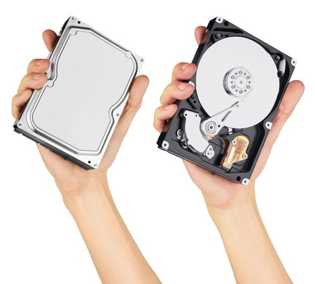 terabyte: hard disk in hand, isolated on white background