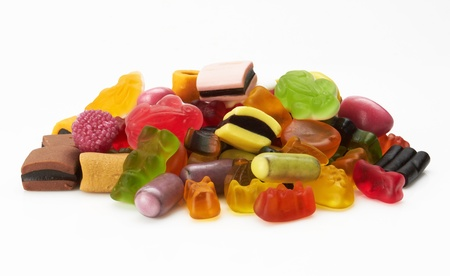 sweet stuff: assortment of colorful candy on white background