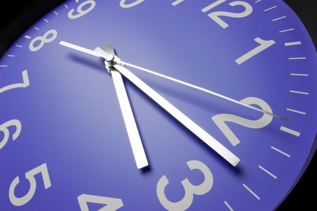 ticking: Blue clock face, close up