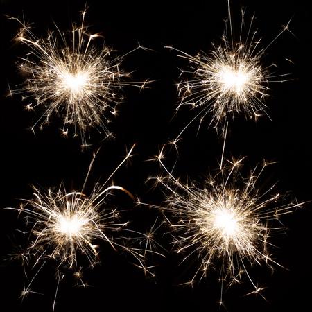 Set of burning christmas sparkler isolated on black background