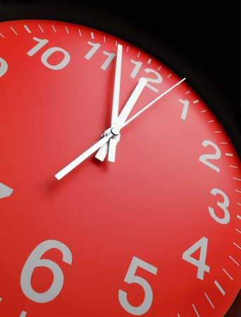 ticking: Red clock face, close up