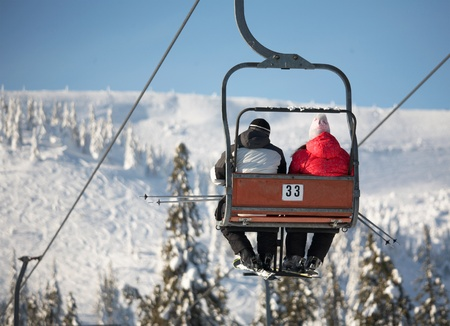 Ski lift carrying skiers photo