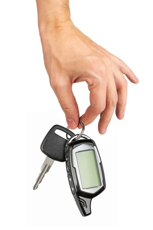 Car key in hand, isolated on white background photo