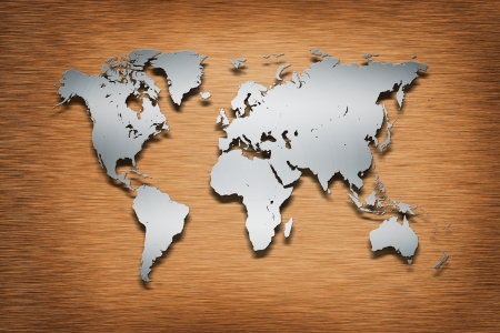 Metal World Map on wood background Stock Photo - 16049747