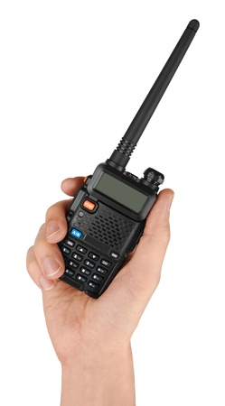 talkie: Portable radio transceiver in hand, isolated on white background
